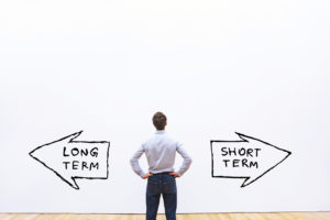 Man viewing short versus long term directions