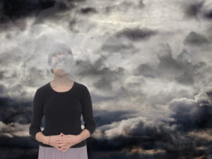 Woman with gray clouds over her