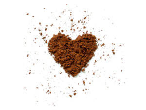 cocoa on white background in shape of a heart